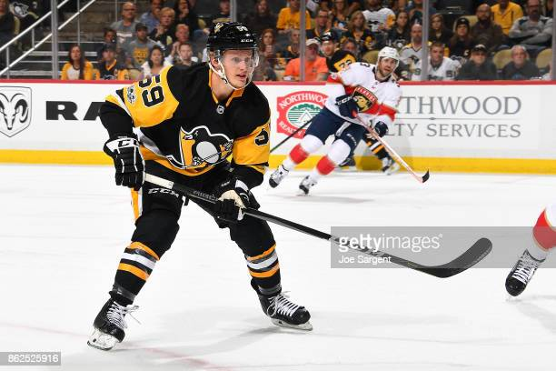 Jake Guentzel of the Pittsburgh Penguins skates against the Florida Panthers at PPG Paints Arena on October 14 2017 in Pittsburgh Pennsylvania