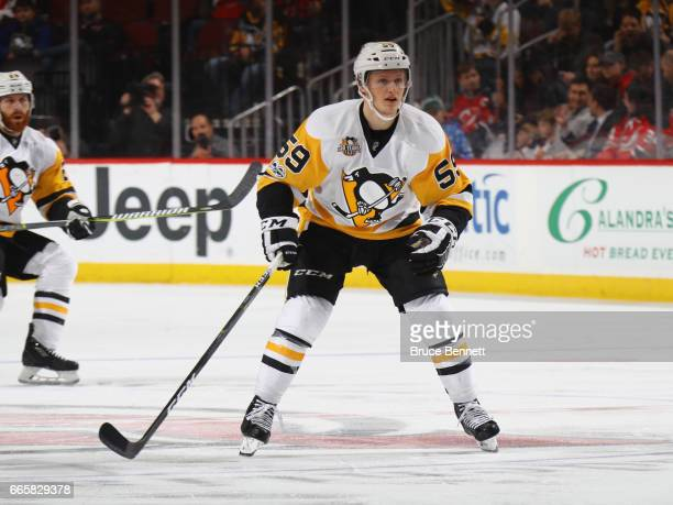Jake Guentzel of the Pittsburgh Penguins skates against the New Jersey Devils at the Prudential Center on April 6 2017 in Newark New Jersey The...