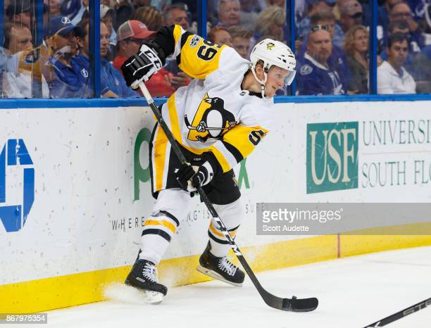Jake Guentzel of the Pittsburgh Penguins skates against the Tampa Bay Lightning at Amalie Arena on October 21 2017 in Tampa Florida 'n