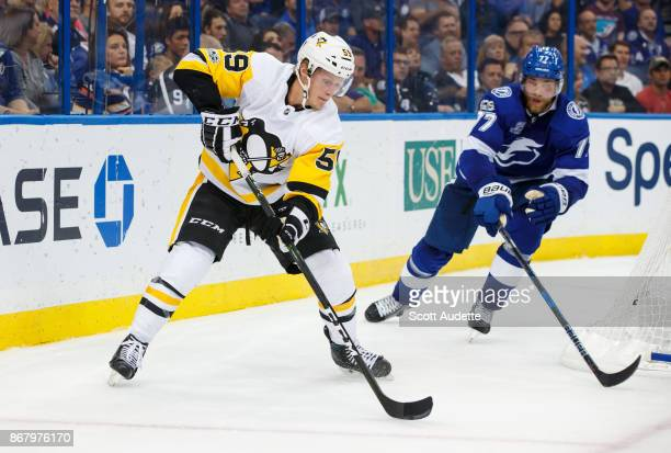Jake Guentzel of the Pittsburgh Penguins skates against the Tampa Bay Lightning at Amalie Arena on October 12 2017 in Tampa Florida 'n