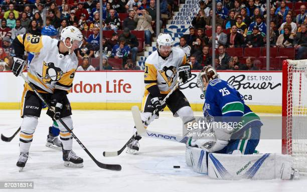 Jake Guentzel of the Pittsburgh Penguins takes a shot against Jacob Markstrom of the Vancouver Canucks during their NHL game at Rogers Arena November...