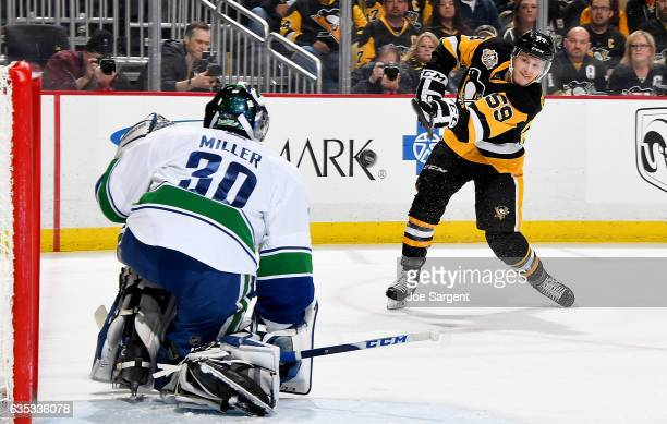 Jake Guentzel of the Pittsburgh Penguins takes a shot on Ryan Miller of the Vancouver Canucks at PPG Paints Arena on February 14 2017 in Pittsburgh...