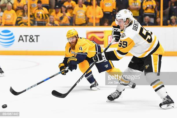 Jake Guentzel of the Pittsburgh Penguins takes a shot past Ryan Ellis of the Nashville Predators during the first period of Game Six of the 2017 NHL...