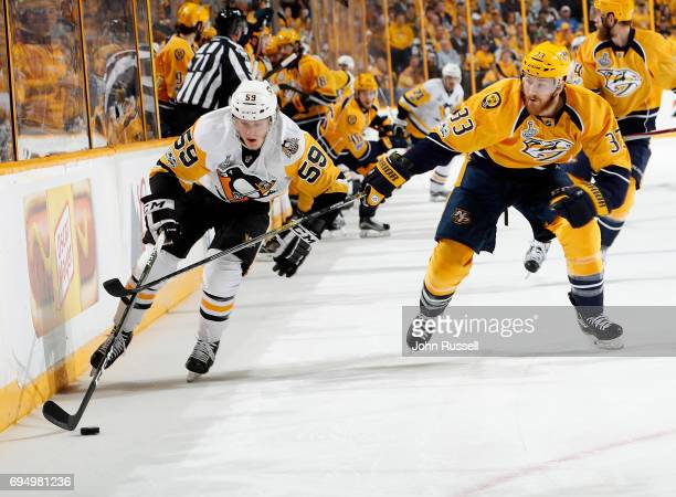 Jake Guentzel of the Pittsburgh Penguins tries to move past Colin Wilson of the Nashville Predators during Game Six of the 2017 NHL Stanley Cup Final...