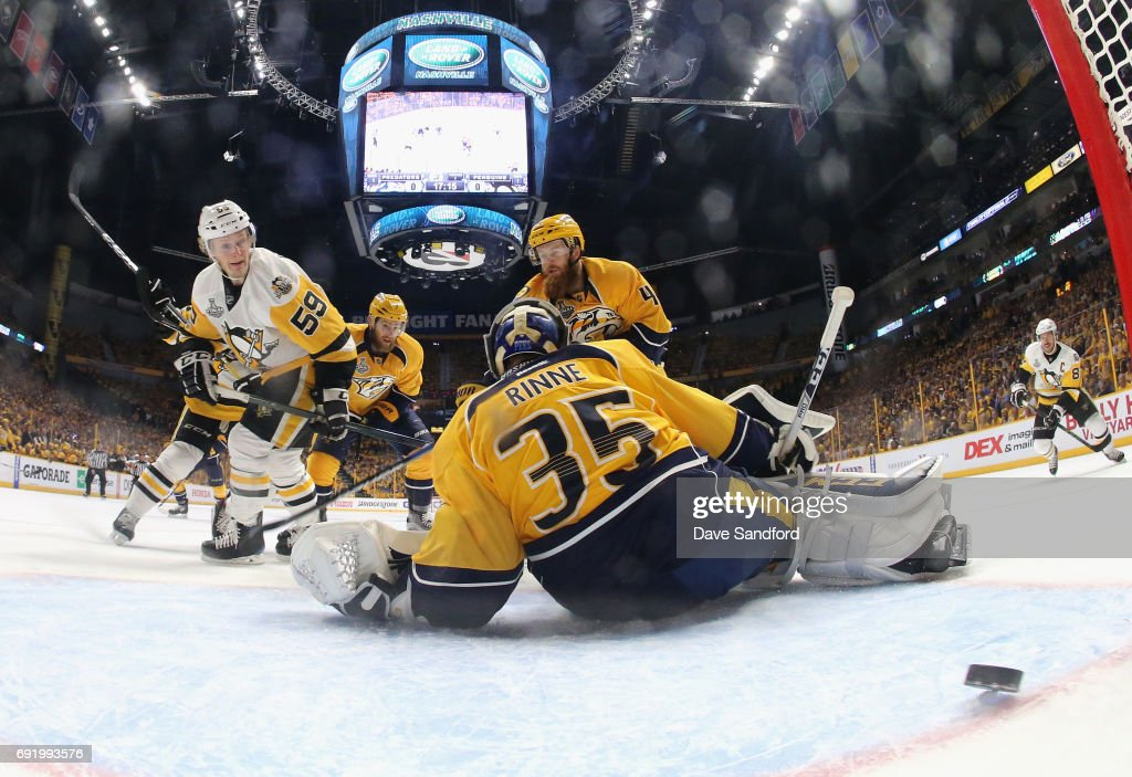Jake Guentzel #59 of the Pittsburgh Penguins watches the puck get past goaltender Pekka Rinne #35 of the Nashville Predators for a goal in the first period of Game Three of the 2017 NHL Stanley Cup Final at Bridgestone Arena on June 3, 2017 in Nashville, Tennessee.