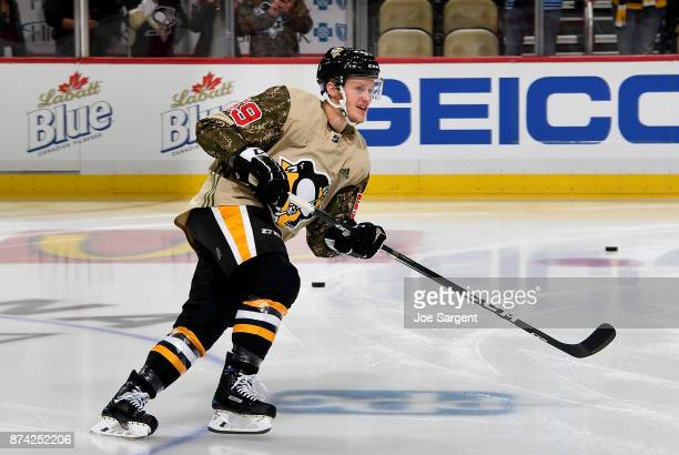 Jake Guentzel of the Pittsburgh Penguins wears a Veterans Day jersey during warmups against the Buffalo Sabres at PPG Paints Arena on November 14...