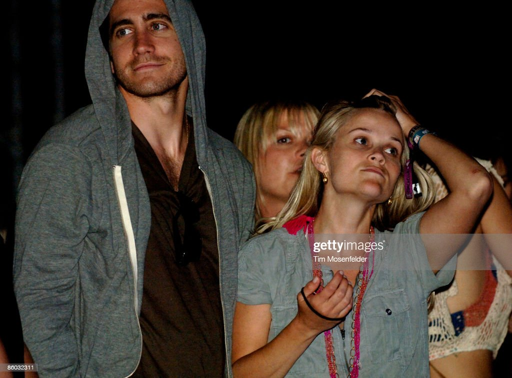 Jake Gyllenhaal and <a gi-track='captionPersonalityLinkClicked' href=/galleries/search?phrase=Reese+Witherspoon&family=editorial&specificpeople=201577 ng-click='$event.stopPropagation()'>Reese Witherspoon</a> attend Jenny Lewis' performance as part of the Coachella Valley Music and Arts Festival at the Empire Polo Fields on April 18, 2009 in Indio, California.