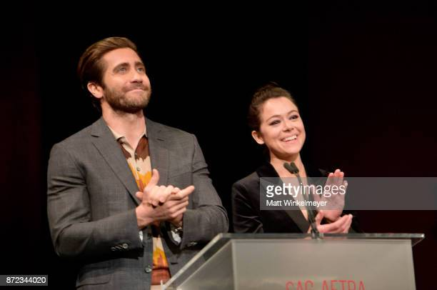 Jake Gyllenhaal and Tatiana Maslany applaud onstage during the SAGAFTRA Foundation Patron of the Artists Awards 2017 at the Wallis Annenberg Center...