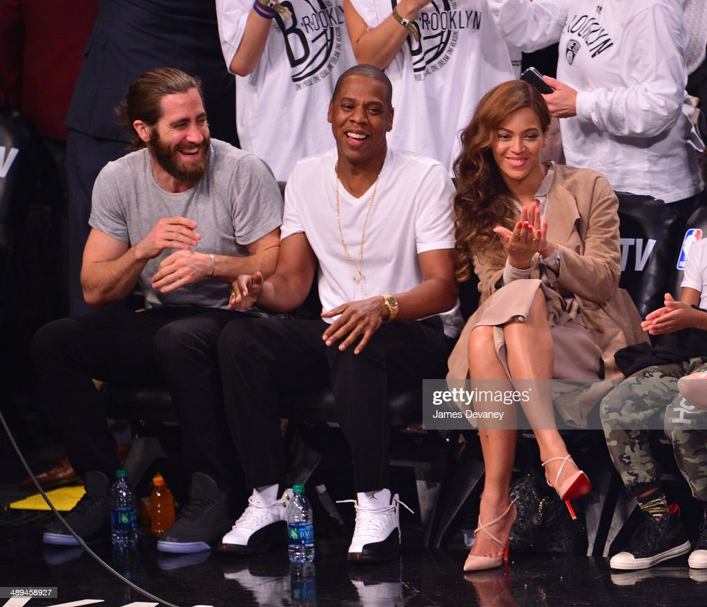 Jake Gyllenhaal, Jay-Z and Beyonce Knowles attend the Miami Heat vs Brooklyn Nets playoff game at Barclays Center on May 10, 2014 in the Brooklyn borough of New York City.