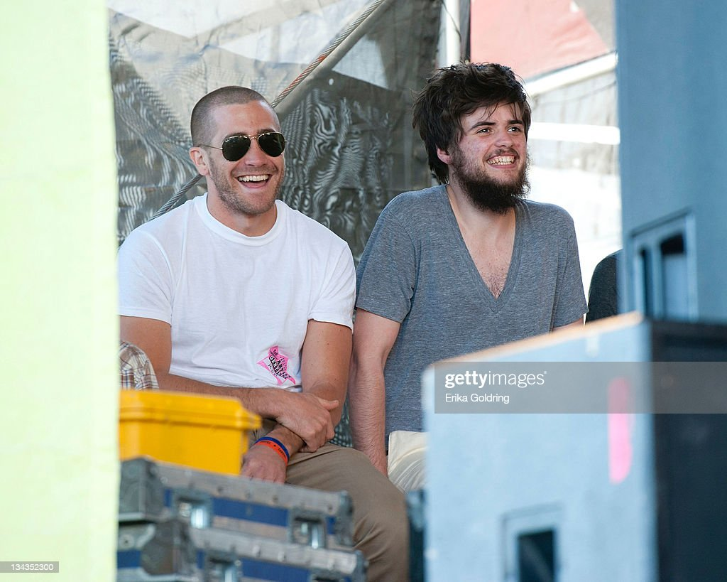 Jake Gyllenhaall and Winston Marshall of Mumford & Sons enjoy <a gi-track='captionPersonalityLinkClicked' href=/galleries/search?phrase=The+Avett+Brothers&family=editorial&specificpeople=4270503 ng-click='$event.stopPropagation()'>The Avett Brothers</a> during day 1 of the 2011 New Orleans Jazz & Heritage Festival at the Fair Grounds Race Course on April 29, 2011 in New Orleans, Louisiana.