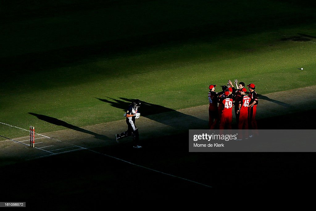 Jake Haberfield of the Redbacks celebrates with team mates after getting the wicket of Cameron White (L) of the Bushrangers during the Ryobi One Cup Day match between the South Australian Redbacks and the Victorian Bushrangers at Adelaide Oval on February 9, 2013 in Adelaide, Australia.