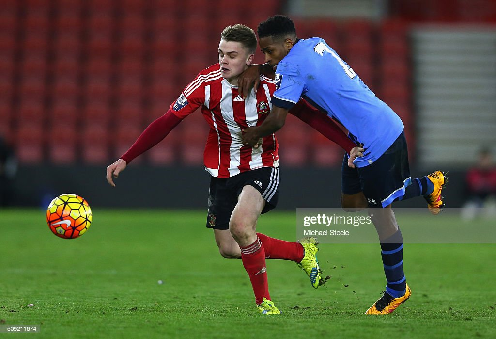 Jake Hesketh of Southampton U21 is challenged by Kyle Walker-Peters of Tottenham Hotspur U21 during the Barclays U21 Premier League match between Southampton and Tottenham Hotspur at St Mary's Stadium on February 9, 2016 in Southampton, England.