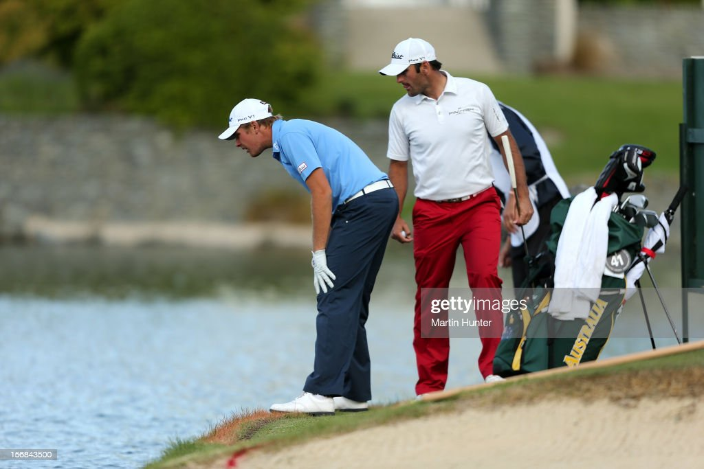 Jake Higginbottom (L) of Australia looks for his ball on the 18th hole with Michael Hendry of New Zealand during day two of the New Zealand Open Championship at Clearwater Golf Course on November 23, 2012 in Christchurch, New Zealand.