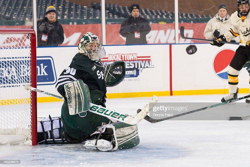 Jake Hildebrand #30 of the Michigan State Spartans makes a kick save against the Michigan Tech Huskeys on December 27, 2013 at Comerica Park in Detroit, Michigan.