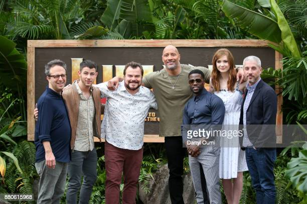 Jake Kasdan Nick Jonas Jack Black Dwayne Johnson Kevin Hart Karen Gillan and Matt Tolmach attend a photocall for Columbia Pictures' 'Jumanji Welcome...