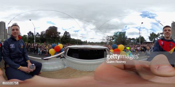 Jake Kelly and Jake Lever of the Crows acknowledge the crowd during the 2017 AFL Grand Final Parade ahead of the Grand Final between the Adelaide...