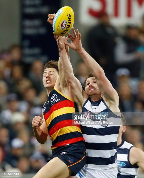 Jake Kelly of the Crows and Patrick Dangerfield of the Cats compete for the ball during the 2017 AFL round 11 match between the Geelong Cats and the...