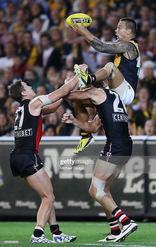 Jake King of the Tigers jumps high but drops a mark over Rhys Stanley of the Saints and <a gi-track='captionPersonalityLinkClicked' href=/galleries/search?phrase=Jason+Blake&family=editorial&specificpeople=202951 ng-click='$event.stopPropagation()'>Jason Blake</a> (L) during the round two AFL match between the St Kilda Saints and the Richmond Tigers at Melbourne Cricket Ground on April 5, 2013 in Melbourne, Australia.
