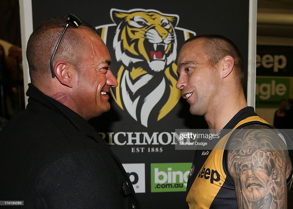 Jake King of the Tigers meets the father of Dustin Martin, Shane Martin, after the round 17 AFL match between the Richmond Tigers and the Fremantle Dockers at Melbourne Cricket Ground on July 21, 2013 in Melbourne, Australia.