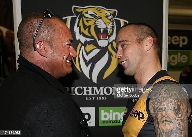 Jake King of the Tigers meets the father of Dustin Martin Shane Martin after the round 17 AFL match between the Richmond Tigers and the Fremantle...