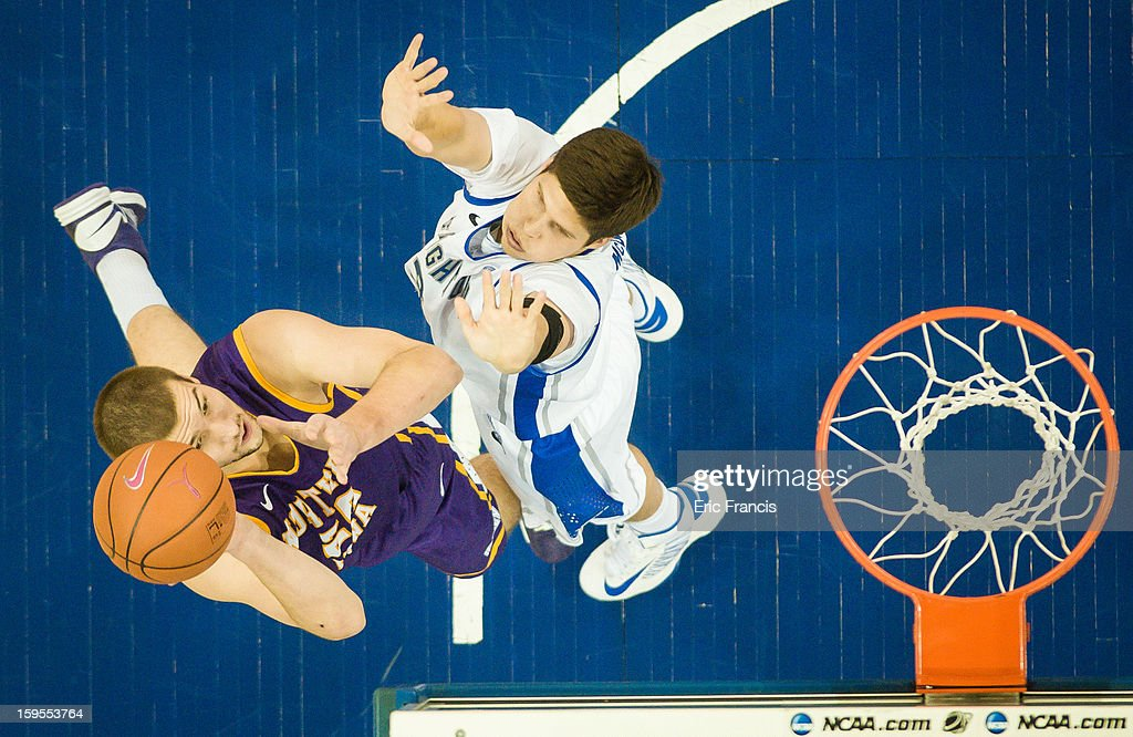 Jake Koch #20 of the Northern Iowa Panthers shoots over <a gi-track='captionPersonalityLinkClicked' href=/galleries/search?phrase=Doug+McDermott&family=editorial&specificpeople=7544468 ng-click='$event.stopPropagation()'>Doug McDermott</a> #3 of the Creighton Bluejays during their game at the CenturyLink Center on January 15, 2013 in Omaha, Nebraska.