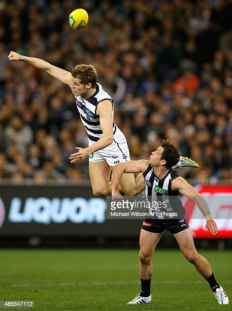 Jake Kolodjashnij of the Cats and Jarryd Blair of the Magpies compete for the ball during the 2015 AFL round 22 match between the Geelong Cats and...