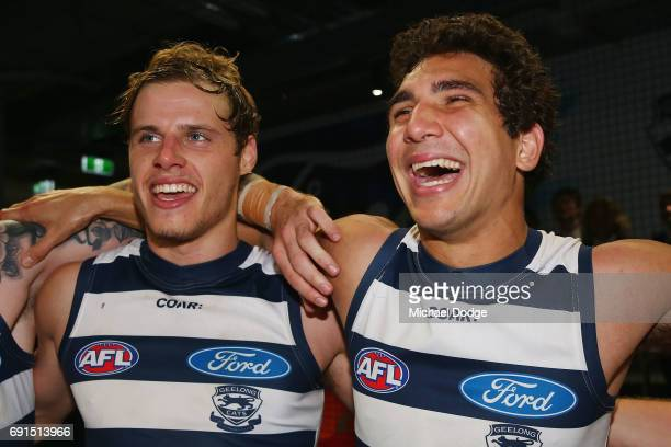 Jake Kolodjashnij of the Cats and Nakia Cockatoo of the Cats sing the club song after winning during the round 11 AFL match between the Geelong Cats...