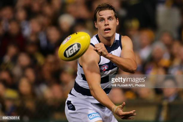 Jake Kolodjashnij of the Cats handpasses the ball during the round 13 AFL match between the West Coast Eagles and the Geelong Cats at Domain Stadium...