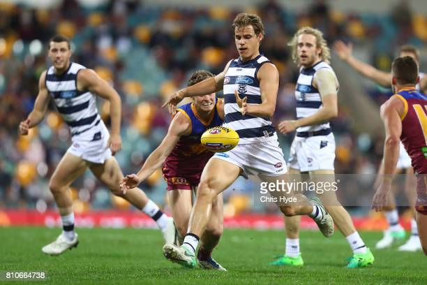 Jake Kolodjashnij of the Cats kicks during the round 16 AFL match between the Brisbane Lions and the Geelong Cats at The Gabba on July 8 2017 in...