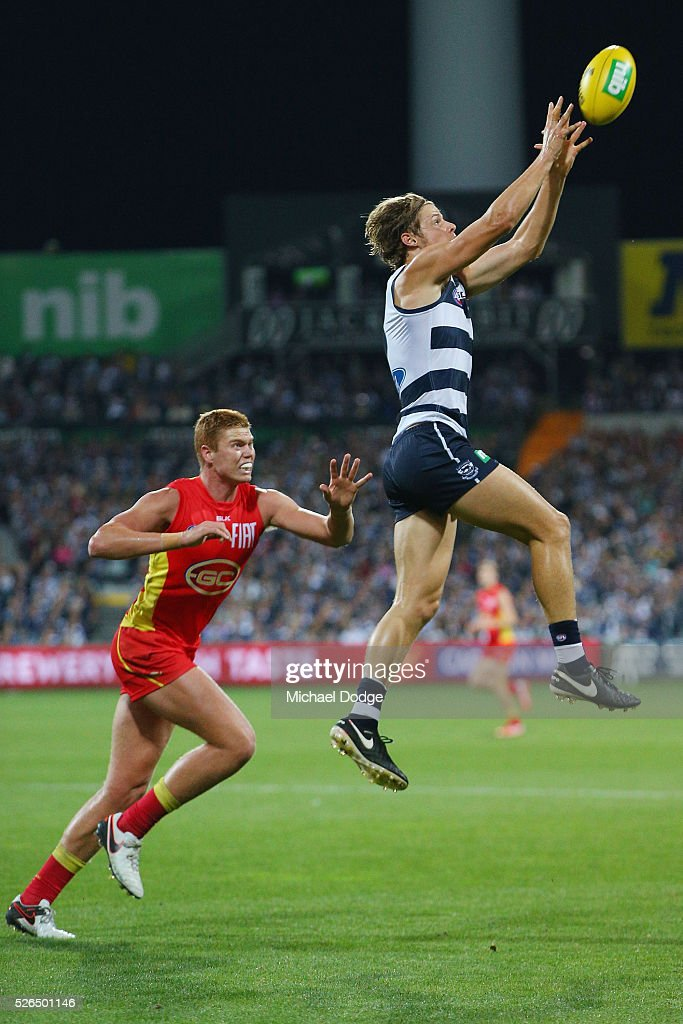 Jake Kolodjashnij of the Cats marks the ball against Peter Wright of the Suns during the round six AFL match between the Geelong Cats and the Gold Coast Suns at Simonds Stadium on April 30, 2016 in Geelong, Australia.