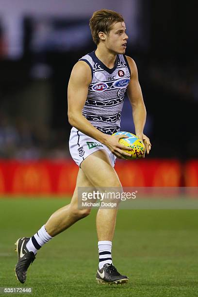 Jake Kolodjashnij of the Cats runs with the ball during the round 10 AFL match between the Carlton Blues and the Geelong Cats at Etihad Stadium on...