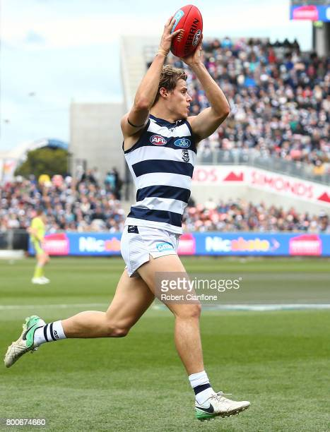 Jake Kolodjashnij of the Cats takes the ball during the round 14 AFL match between the Geelong Cats and the Fremantle Dockers at Simonds Stadium on...