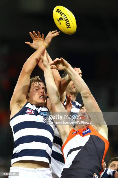 Jake Kolodjashnji of the Cats and Jeremy Cameron of the Giants contest the ball during the round 15 AFL match between the Greater Western Sydney...