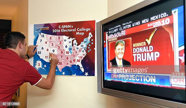 Jake Krupa colors in an electoral map as states projected for Republican presidential candidate Donald Trump or Democratic Presidential candidate...