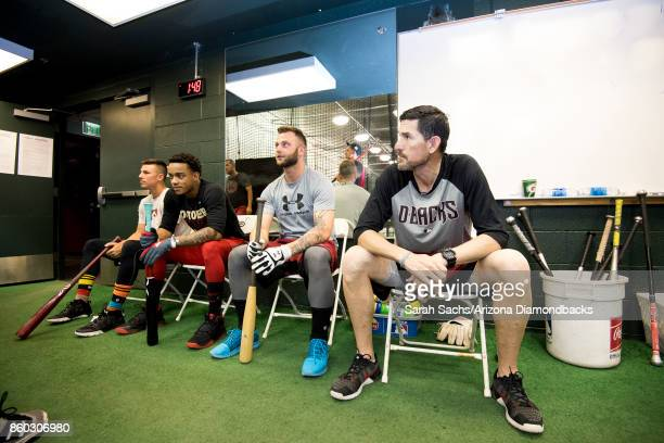 Jake Lamb Ketel Marte Christian Walker and Tim Laker of the Arizona Diamondbacks work out in the batting cages the day before game three of the...