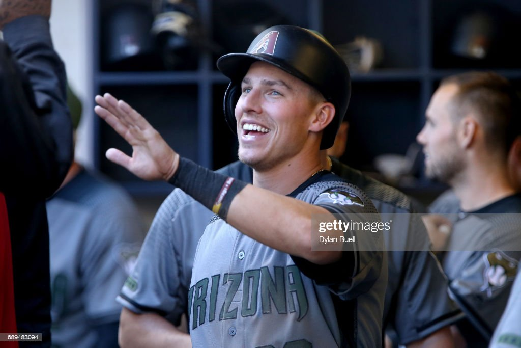 Jake Lamb #22 of the Arizona Diamondbacks celebrates with teammates after scoring a run in the eighth inning against the Milwaukee Brewers at Miller Park on May 28, 2017 in Milwaukee, Wisconsin.