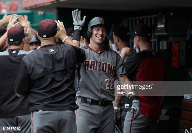 Jake Lamb of the Arizona Diamondbacks celebrates with teammates after hitting a three run home run in the first inning against the Cincinnati Reds at...