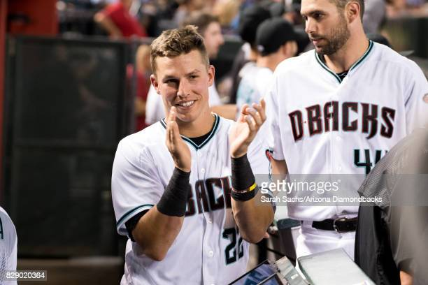Jake Lamb of the Arizona Diamondbacks claps from the dugout during a game against the Los Angeles Dodgers at Chase Field on August 8 2017 in Phoenix...