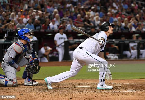 Jake Lamb of the Arizona Diamondbacks follows through on a grand slam home run during the seventh inning against the Los Angeles Dodgers at Chase...