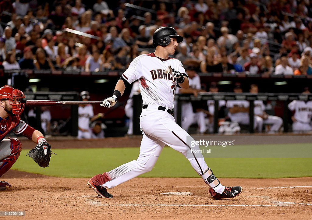 Jake Lamb #22 of the Arizona Diamondbacks follows through on a swing against the Philadelphia Phillies at Chase Field on June 27, 2016 in Phoenix, Arizona.