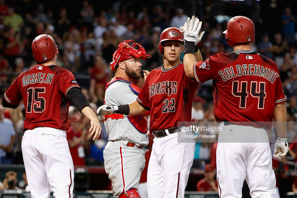Jake Lamb #22 of the Arizona Diamondbacks high fives Phil Gosselin #15 and Paul Goldschmidt #44 after hitting a three-run home run against the Philadelphia Phillies during the first inning of the MLB game at Chase Field on June 29, 2016 in Phoenix, Arizona.