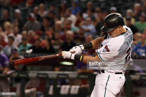 Jake Lamb of the Arizona Diamondbacks hits a RBI double against the Colorado Rockies during the second inning of the MLB game at Chase Field on June...