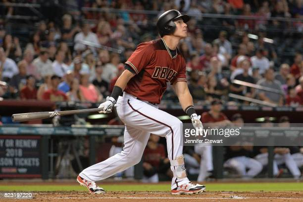 Jake Lamb of the Arizona Diamondbacks hits a sacrifice fly ball against the Atlanta Braves during the first inning at Chase Field on July 26 2017 in...