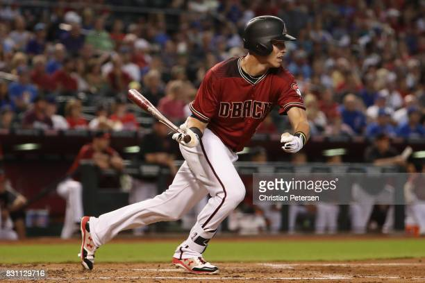 Jake Lamb of the Arizona Diamondbacks hits a single against the Chicago Cubs during the first inning of the MLB game at Chase Field on August 13 2017...
