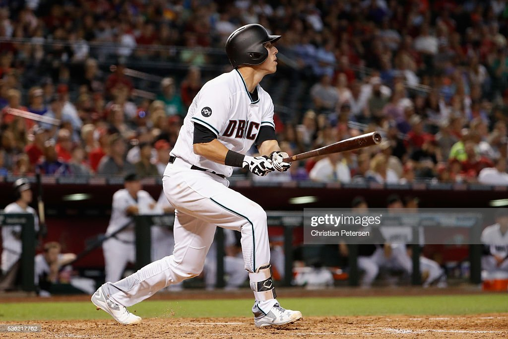 Jake Lamb #22 of the Arizona Diamondbacks hits a single against the Houston Astros during the fifth inning of the MLB game at Chase Field on May 31, 2016 in Phoenix, Arizona.