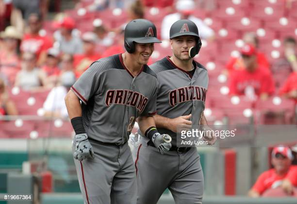 Jake Lamb of the Arizona Diamondbacks is all smiles after hitting a three run home run in the first inning against the Cincinnati Reds at Great...