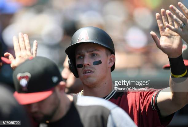 Jake Lamb of the Arizona Diamondbacks is congratulated by teammates after he scored against the San Francisco Giants in the top of the fourth inning...