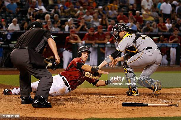 Jake Lamb of the Arizona Diamondbacks is tagged out at home plate by catcher Chris Stewart of the Pittsburgh Pirates during the 10th inning of the...