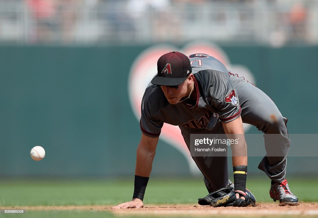 Jake Lamb #22 of the Arizona Diamondbacks is unable to field a ball hit by Byron Buxton #25 of the Minnesota Twins during the third inning of the game on August 20, 2017 at Target Field in Minneapolis, Minnesota. The Twins defeated the Diamondbacks 12-5.