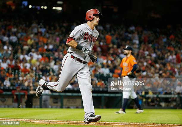 Jake Lamb of the Arizona Diamondbacks rounds the bases after hitting a solo home run in the tenth inning off Pat Neshek of the Houston Astros during...